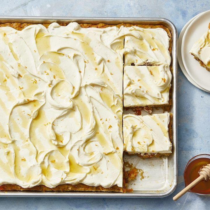 "<p>This springtime classic, full of carrots and honey and topped with a sweet and creamy frosting, is fit for a crowd. </p><p><em><a href=""https://www.goodhousekeeping.com/food-recipes/dessert/a30996763/carrot-sheet-cake-recipe/"" rel=""nofollow noopener"" target=""_blank"" data-ylk=""slk:Get the recipe for Carrot Sheet Cake »"" class=""link rapid-noclick-resp"">Get the recipe for Carrot Sheet Cake »</a></em> </p>"