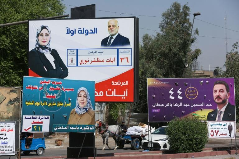 In theory, Iraq's new electoral law will strengthen local voices but the shadow of traditional political blocs hovers over many candidates (AFP/Ahmad AL-RUBAYE)