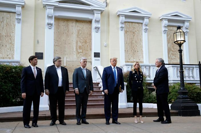 President Donald Trump stands outside St. John's Church across Lafayette Park from the White House Monday, June 1, 2020, in Washington. Part of the church was set on fire during protests on Sunday night. Standing with Trump are Defense Secretary Mark Esper, from left, Attorney General William Barr, White House national security adviser Robert O'Brien, White House press secretary Kayleigh McEnany and White House chief of staff Mark Meadows.