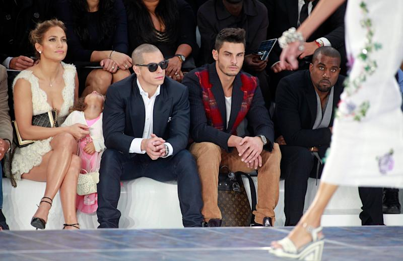 Jennifer Lopez, her boyfriend Casper Smart, her daughter Emme, model Baptiste Giabiconi, 2nd right, and Kanye West, right, watch Chanel's ready to wear Spring-Summer 2013 collection, presented in Paris, Tuesday, Oct.2, 2012. (AP Photo/Thibault Camus)