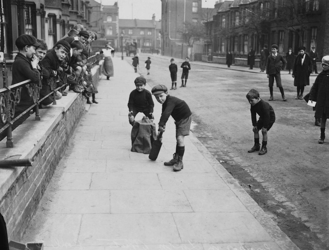 6th March 1926:  Young boys playing cricket in a London street.  (Photo by Central Press/Getty Images)