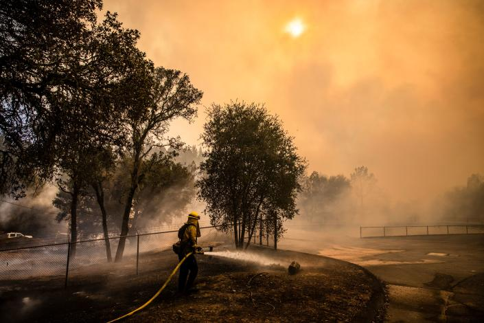 Fire Fighters with Cal Fire work to protect the St. Helena Water Treatment Plant from the Glass Fire in Napa Valley, California on September 27, 2020. (Samuel Corum/AFP via Getty Images)