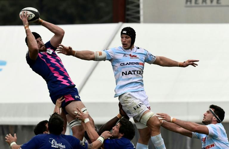 Stade Francais' Hugh Pyle (left) outjumps Racing 92's Wenceslas Lauret during a French league match in Colombes in October 2016