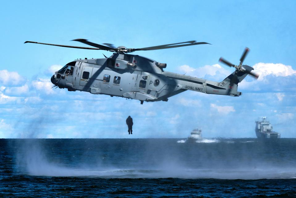 Image of a Royal Marine from 4 Assault Squadron, HMS Albion, jumping (Helocasting) from a Merlin helicopter into the sea to link up with inflatable raiding craft during an amphibious landing exercise taking place at Kolga Bay, Estonia (Picture: UK MOD/Crown 2019)