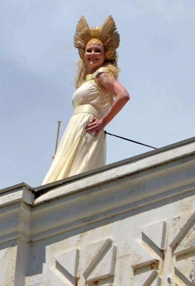 **EXCLUSIVE** Kirsten Dunst breaks out a long horn and long white dress to film a rooftop scene for 'Anchorman: The Legend Continues' in Atlanta