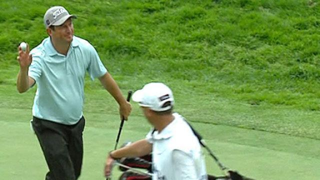 Tim Clark makes a hole-in-one at the par-3 11th on Sunday at the PGA Championship