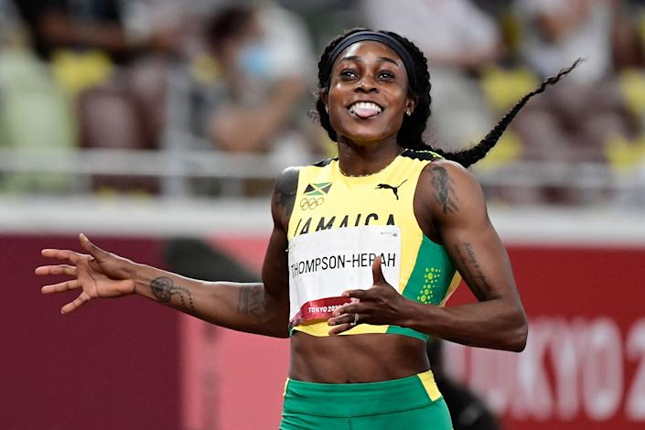 <p>Jamaica's Elaine Thompson-Herah wins the women's 200m final during the Tokyo 2020 Olympic Games at the Olympic Stadium in Tokyo on August 3, 2021. (Photo by Javier SORIANO / AFP) (Photo by JAVIER SORIANO/AFP via Getty Images)</p>