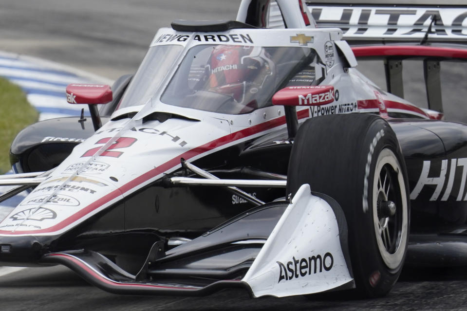FILE - In this June 12, 2021, file photo, Josef Newgarden drives during the first race of the IndyCar Detroit Grand Prix auto racing doubleheader on Belle Isle in Detroit. Newgarden won the pole position Saturday, June 19, for Sunday's IndyCar race at Road America in Elkhart Lake, Wis. (AP Photo/Paul Sancya, File)