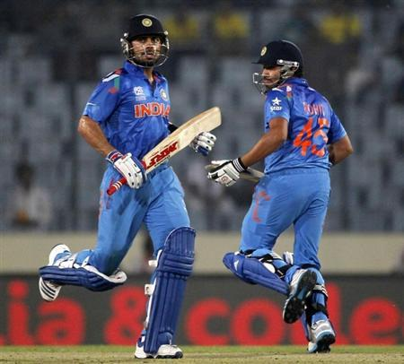 India's Kohli and Sharma run between the wickets against West Indies during their ICC Twenty20 World Cup match in Dhaka