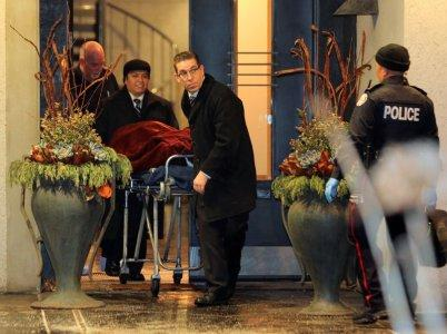 One of two bodies is removed from the home of billionaire founder of Canadian pharmaceutical firm Apotex Inc., Barry Sherman and his wife Honey, who were found dead under circumstances that police described as