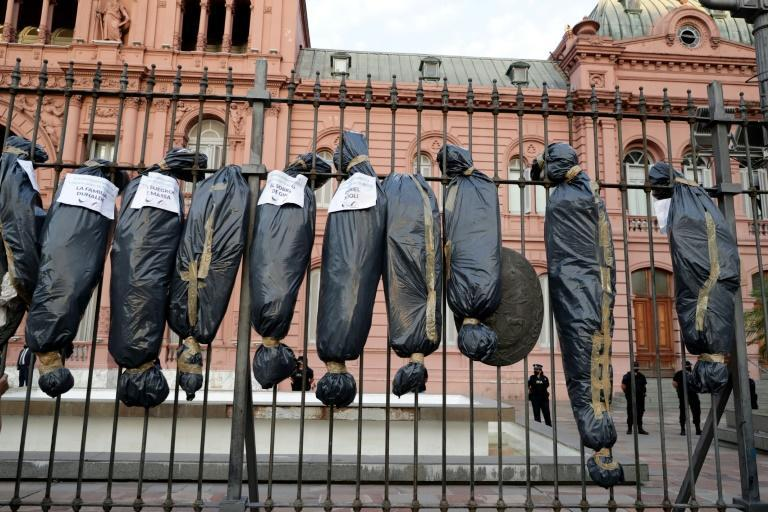 Demonstrators hung mock body bags in front of the Casa Rosada presidential office in Buenos Aires to protest against a scandal over vaccine line-jumping