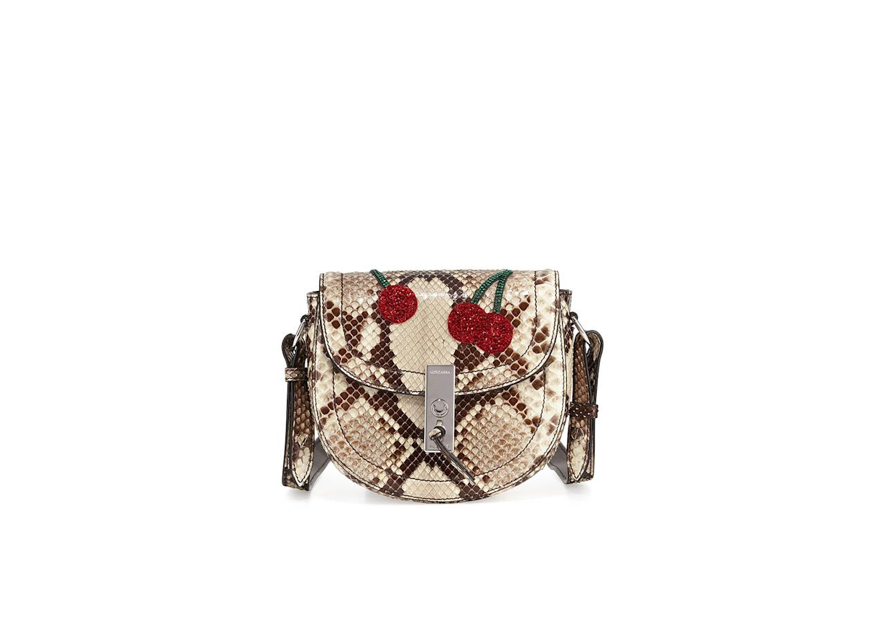 "<p>Altuzarra Mini Python Saddle Bag with Sequined Cherries, $2,595, <a rel=""nofollow"" href=""http://www.bergdorfgoodman.com/Altuzarra-Ghianda-Mini-Python-Saddle-Bag-with-Sequined-Cherries-Gray-Pattern-Altuzarra/prod125610011_cat372203__/p.prod?icid=&searchType=EndecaDrivenCat&rte=%252Fcategory.jsp%253FitemId%253Dcat372203%2526pageSize%253D120%2526Nao%253D0%2526refinements%253D&eItemId=prod125610011&cmCat=product"">BergdorfGoodman.com</a> </p>"