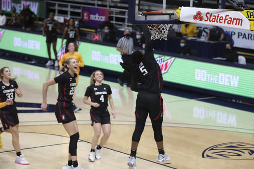 Stanford's Francesca Belibi (5) dunks the ball against California during the first half of an NCAA college basketball game Sunday, Dec. 13, 2020, in Berkeley, Calif. (AP Photo/Jed Jacobsohn)