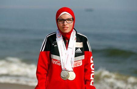 Special olympics athlete Alaa Abdelaziz wears medals on a beach in Alexandria, Egypt, July 18, 2017. REUTERS/Mohamed Abd El Ghany