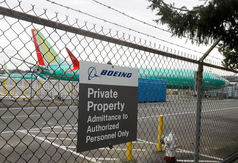 A Boeing 737 MAX 8 being built for for Shanghai Airlines sits parked at Boeing Co.'s Renton Assembly Plant, Monday, March 11, 2019, in Renton, Wash. Airlines in several countries grounded the same model jetliner Monday following Sunday's crash of an Ethiopian Airlines Boeing 737 Max 8, the second devastating crash of one of the planes in five months. (AP Photo/Ted S. Warren)