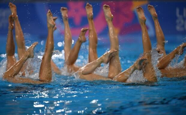 Canada's Artistic Swimming team is seen performing at the 2019 Pan Am Games in Lima, Peru.  (Pedro Pardo/Getty Images - image credit)