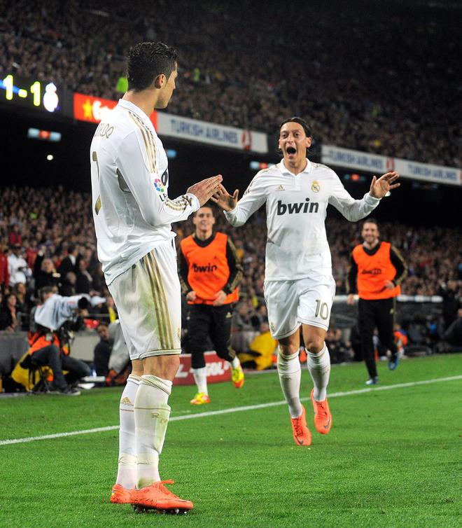 BARCELONA, SPAIN - APRIL 21:  Cristiano Ronaldo (L) of Real Madrid CF celebrates with Mesut Ozil after scoring his team's 2nd goal during the La Liga match between FC Barcelona and Real Madrid CF at Camp Nou on April 21, 2012 in Barcelona, Spain.  (Photo by Denis Doyle/Getty Images)