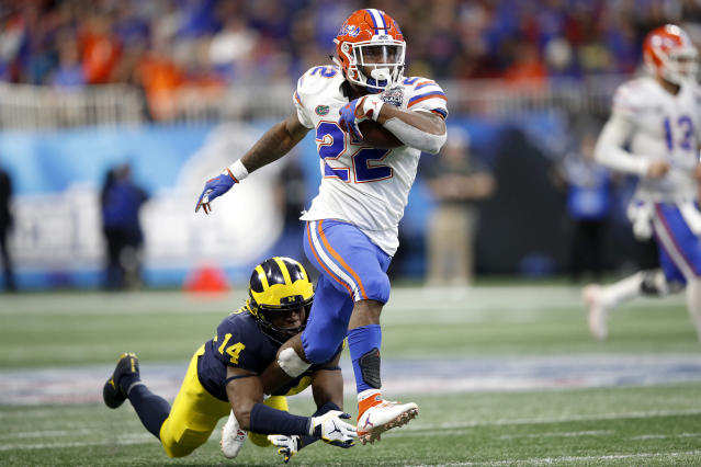 "Florida running back <a class=""link rapid-noclick-resp"" href=""/ncaaf/players/267139/"" data-ylk=""slk:Lamical Perine"">Lamical Perine</a>'s 52-yard touchdown put the game out of reach for Michigan. (Photo by Joe Robbins/Getty Images)"
