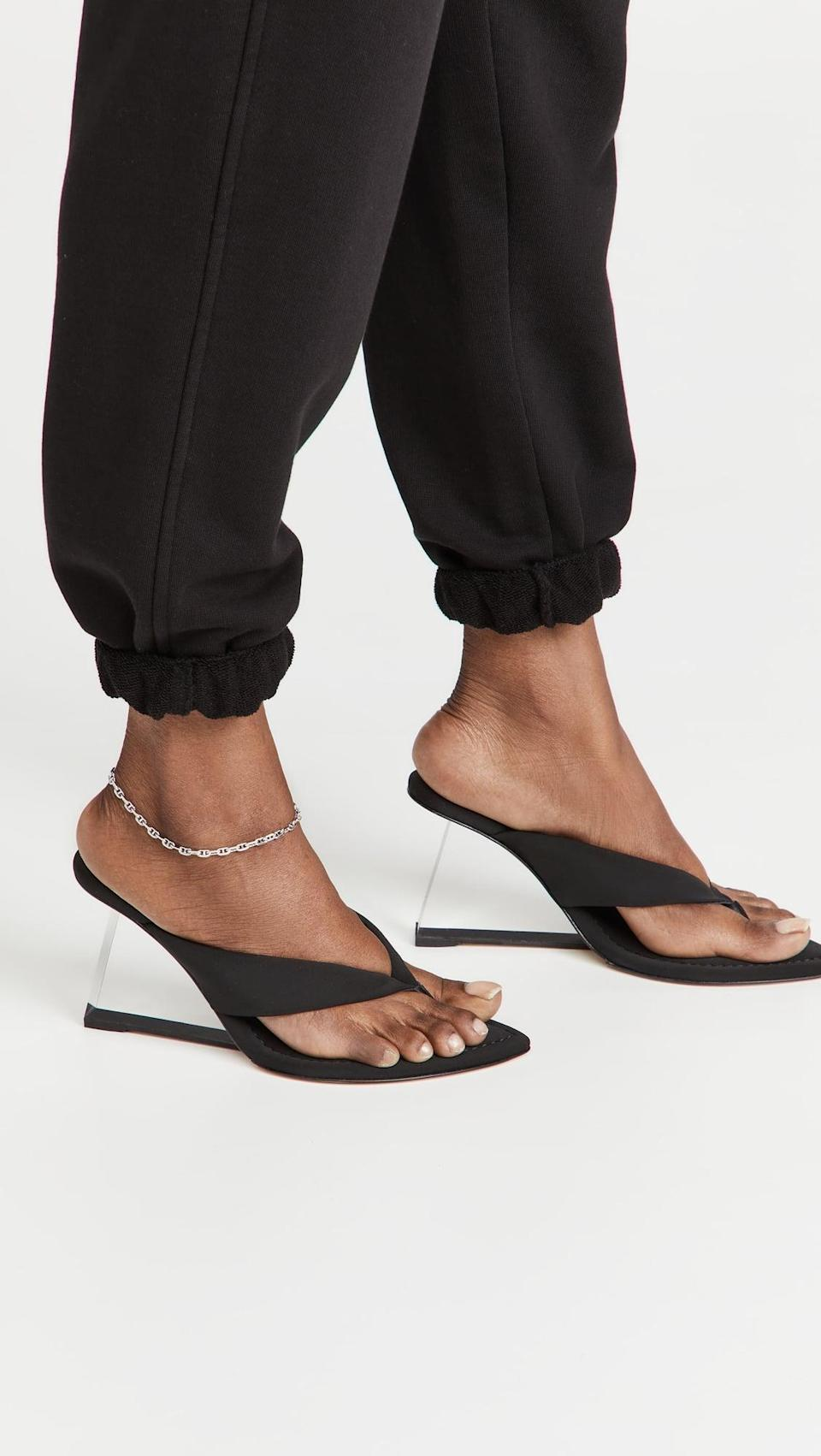 <p>These <span>Good American Clear Block Heel Thong Sandals</span> ($195) won't sink into grass, which is the goal. They are cool looking and will make you feel like you can take on anything.</p>