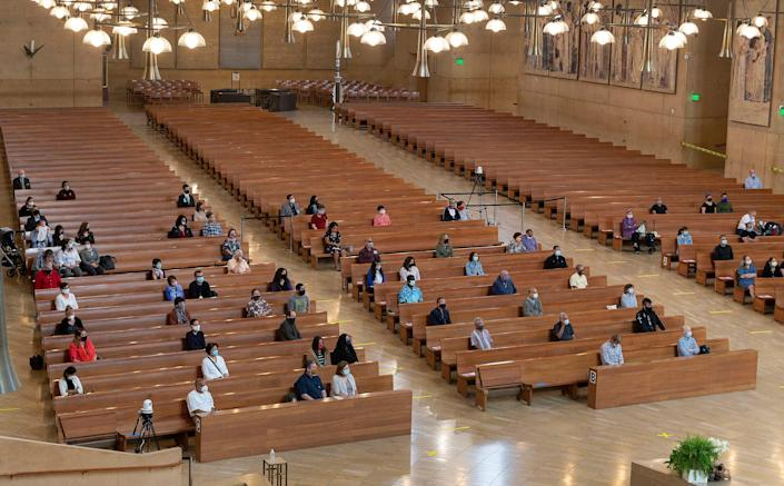 About 100 people gather in July for Mass at the Cathedral of Our Lady of the Angels in Los Angeles for its first in-person service in months.