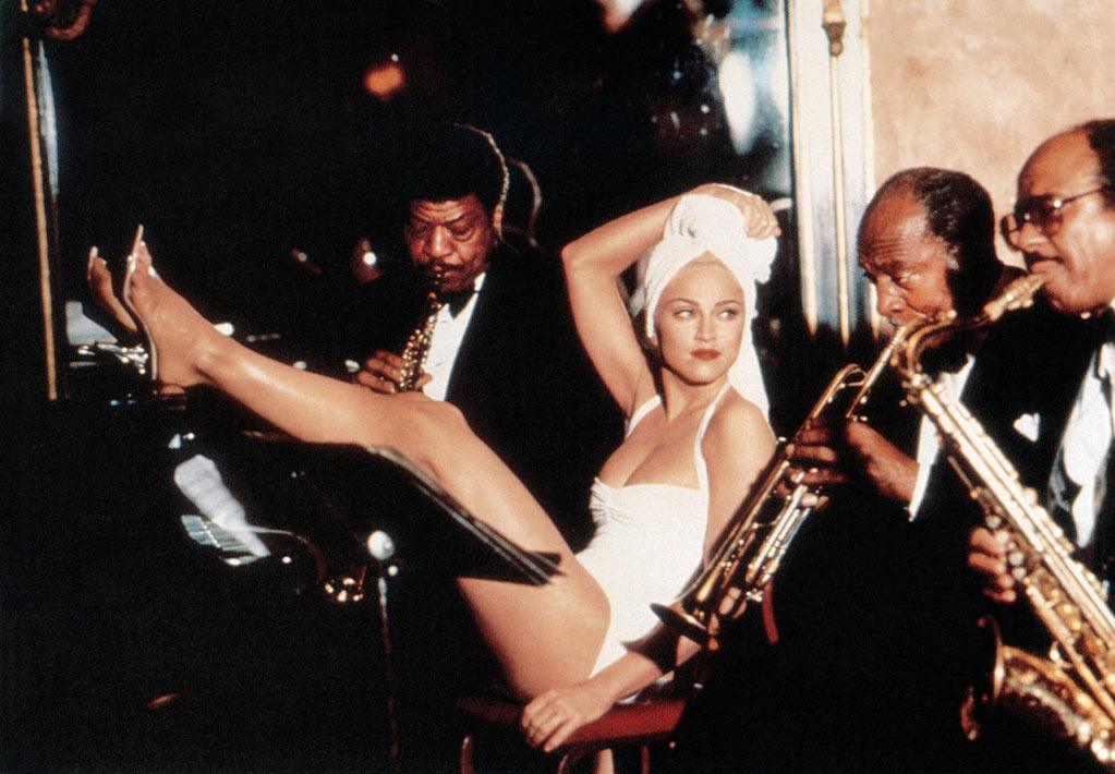 """<a href=""""http://movies.yahoo.com/movie/madonna-truth-or-dare/"""">TRUTH OR DARE</a> (1991) <br> Directed by: Alek Keshishian<a href=""""http://movies.yahoo.com/movie/contributor/1800157889""""></a><br><br>Released in the spring of 1991 -- following the successes of Madonna's fourth studio album (""""Like a Prayer""""), comic book blockbuster """"Dick Tracy"""", and the Blond Ambition World Tour -- """"Madonna: Truth or Dare"""" solidified the Material Girl's status as history's greatest self-promoter. Perceived by many as the ultimate advertisement, the black-and-white, Alek Keshishian-directed doc is beloved by fans for its behind-the-scenes peek into Madonna's heavily guarded private life and maligned by others for its overly produced scenes. Either way, it captivated audiences upon arrival, kept Madonna's name in lights, and easily became -- at that point -- the highest-grossing documentary of all time (a title it held for 11 years, until the release of fellow Michigan native Michael Moore's """"Bowling for Columbine""""), with a worldwide gross of nearly $30 million."""