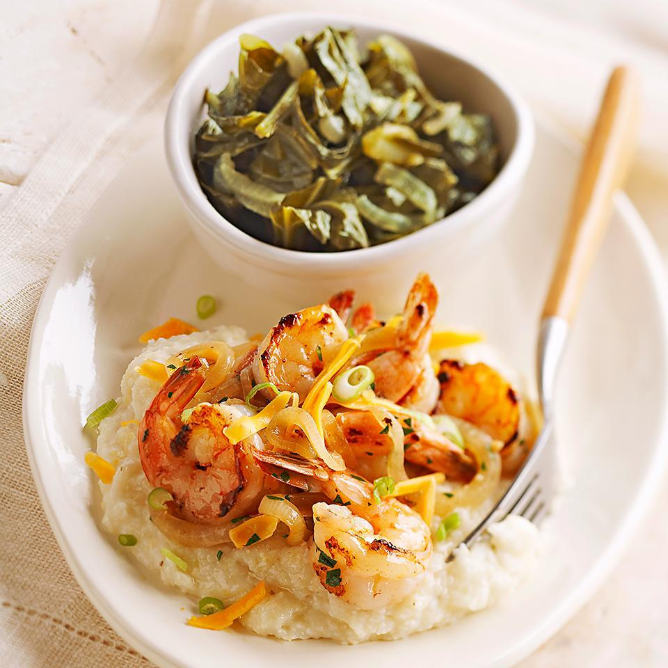 """<p>Onion and garlic season the shrimp, which is served on a bed of grits and topped off with cheese and green onions in this simple recipe. <a href=""""http://www.eatingwell.com/recipe/265268/shrimp-and-grits/"""" rel=""""nofollow noopener"""" target=""""_blank"""" data-ylk=""""slk:View recipe"""" class=""""link rapid-noclick-resp""""> View recipe </a></p>"""