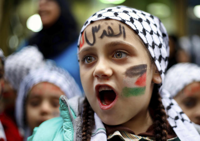 "<p>A girl with a Palestinian flag and Arabic that read ""Jerusalem is for us"" painted on her face chants slogans during a sit-in in the Bourj al-Barajneh Palestinian refugee camp in Beirut, Lebanon, Wednesday, Dec. 6, 2017. (Photo: Bilal Hussein/AP) </p>"