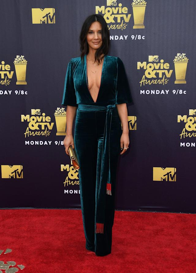 <p>Wearing a green Galvan jumpsuit with a plunging neckline, Christian Louboutin heels, a Bvlgari clutch, and jewelry by Anita Ko and Eva Fehren. </p>