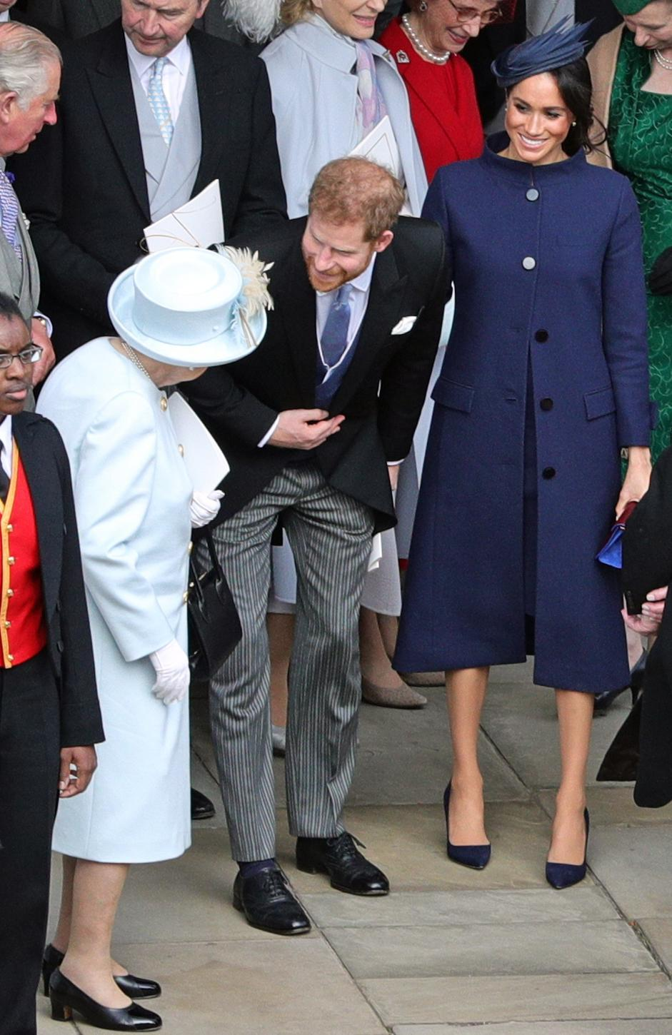 Meghan wore a navy coat by Givenchy (PA)