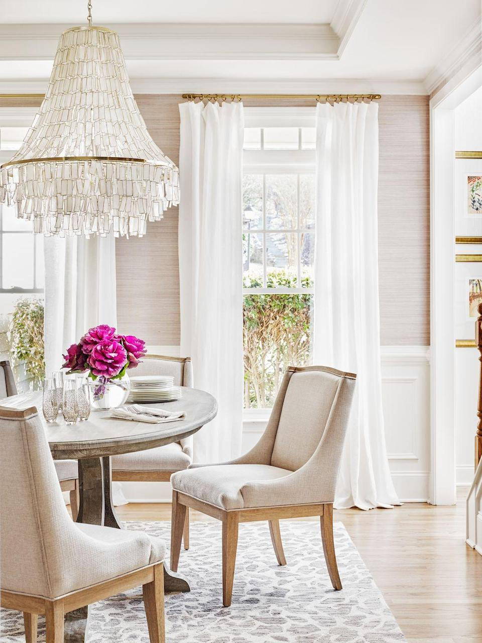 """<p>""""Grasscloth is one of my favorite materials for a nuanced and organic yet tailored feel,"""" says Atlanta-based designer Theresa Ory. """"Grasscloth is quite versatile—I've personally used it in dining rooms and powder rooms, as well as a lining for built-ins and above paneling in hallways."""" We love this creamy grasscloth she selected for this natural light-drenched dining room.</p><p>Ory's pro tip: """"You can find grasscloth in many colors, finishes and weaves, which allows for flexibility of use. Thibault even has a vinyl version that is wipeable and very bathroom friendly.""""<br></p>"""
