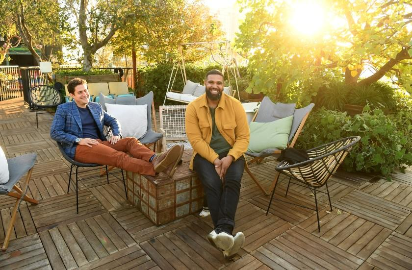 HOLLYWOOD, CALIFORNIA NOVEMBER 24 11, 2020-Co-founders Joe Green, left, and Prophet Walker stand on the rooftop garden at the Treehouse, a co-living apartment building in Hollywood. (Los Angeles Times/Wally Skalij)