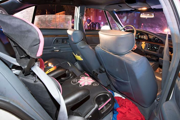 A child's car seat is seen at the rear of Philando Castile's car.