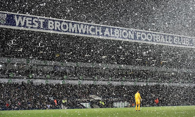 West Bromwich Albion's Ben Foster stand in the snow during the 3-1 defeat by Manchester City played on Boxing Day 2014 at The Hawthorns.