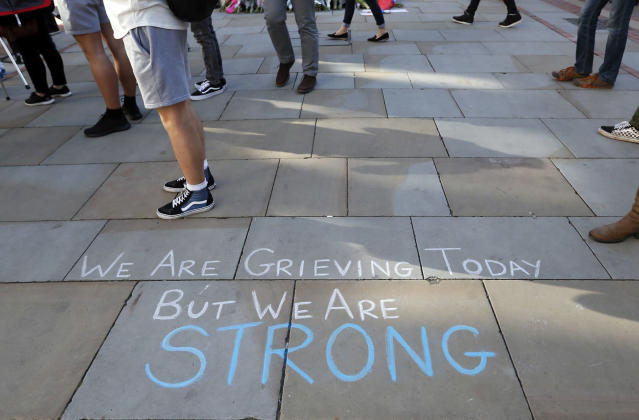 <p>A message is written on the pavement in Manchester, England, Tuesday May 23, 2017, the day after the suicide attack at an Ariana Grande concert that left 22 people dead as it ended on Monday night. (Photo: Kirsty Wigglesworth) </p>