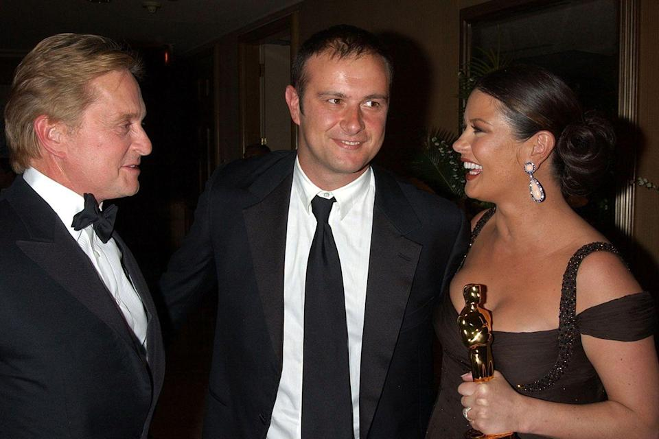 <p>Catherine Zeta-Jones had her Best Supporting Actress Oscar in-hand while hanging with her brother at the Miramax After Party.</p>