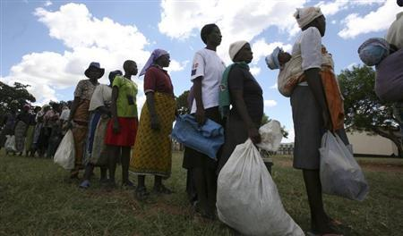 Zimbabwean villagers collect their monthly rations of food aid from Rutaura Primary School in Rushinga district of Mt Darwin about 254km north of Harare