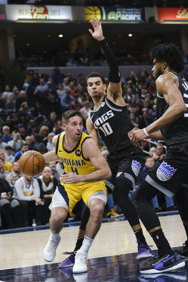 Indiana Pacers guard T.J. McConnell (9) works around Sacramento Kings guard Justin James (10) during the second half of an NBA basketball game in Indianapolis, Friday, Dec. 20, 2019. The Pacers won 119-105. (AP Photo/AJ Mast)