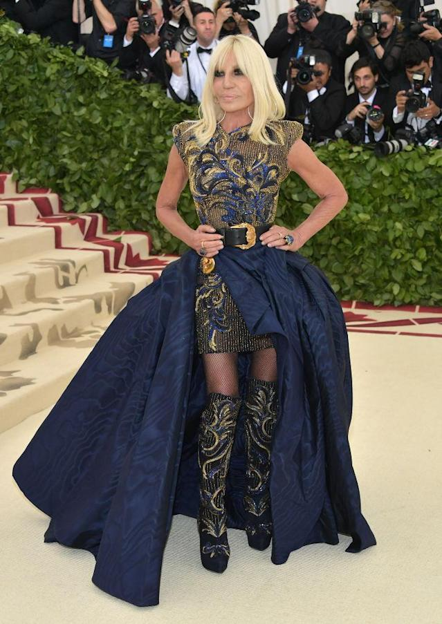 <p>Donatella went with a standout skirt over-top a dress from Versace, of course. (Photo: Getty Images) </p>