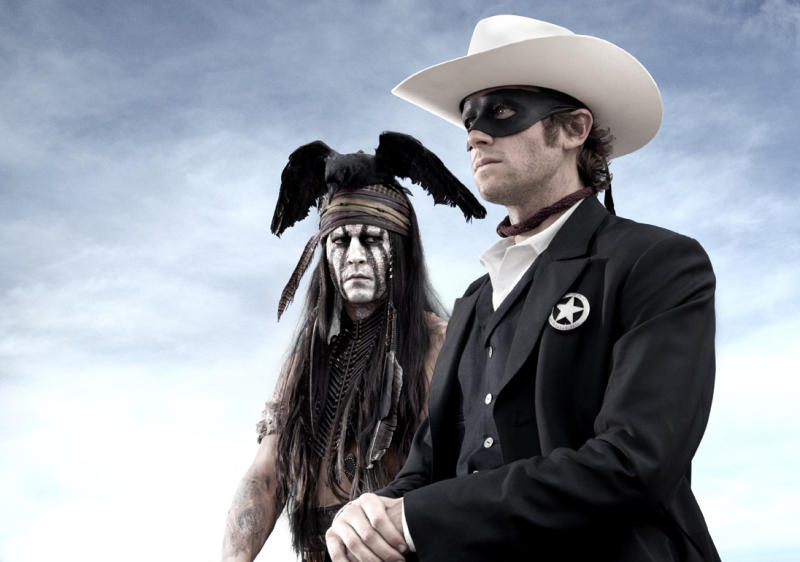 """FILE - This undated publicity photo from Disney/Bruckheimer Films, shows actors, Johnny Depp, left, as Tonto, a spirit warrior on a personal quest, who joins forces in a fight for justice with Armie Hammer, as John Reid, a lawman who has become a masked avenger, The Lone Ranger, from the movie, """"The Lone Ranger."""" The film opens nationwide on July 3, 2013. (AP Photo/Disney/Bruckheimer Films, Peter Mountain, File)"""