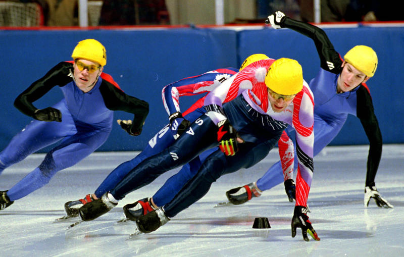 FILE - In this Jan. 18, 1998, file photo, Andy Gabel, foreground, skates to first place during the men's 1,000-meter short track speedskating Olympic trials in Lake Placid, N.Y. U.S. Speedskating began an investigation Friday, March 1, 2013, into the report of a female skater accusing former Olympian and organization president Andy Gabel of sexual abuse in the 1990s. (AP Photo/Nancie Battaglia, File)