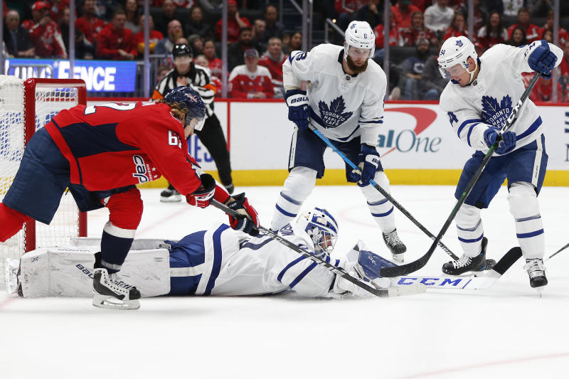 Oct 16, 2019; Washington, DC, USA; Toronto Maple Leafs goaltender Michael Hutchinson (30) makes a save as Washington Capitals left wing Carl Hagelin (62) reaches for the puck during the third period at Capital One Arena. Mandatory Credit: Amber Searls-USA TODAY Sports