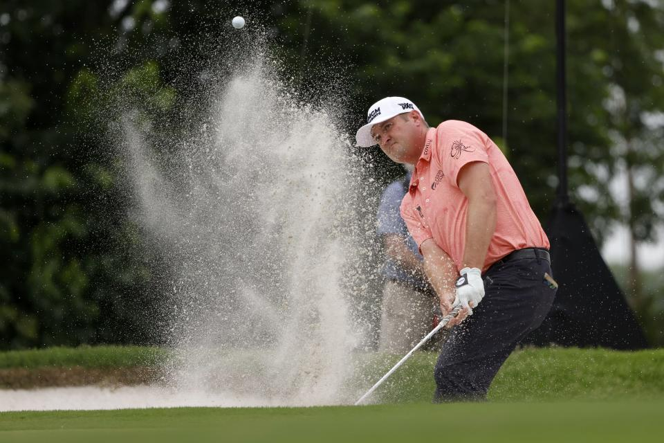 Jason Kokrak hits out of a bunker on the seventh green during the final round of the Charles Schwab Challenge golf tournament at Colonial Country Club in Fort Worth, Texas, Sunday, May 30, 2021. (AP Photo/Michael Ainsworth)
