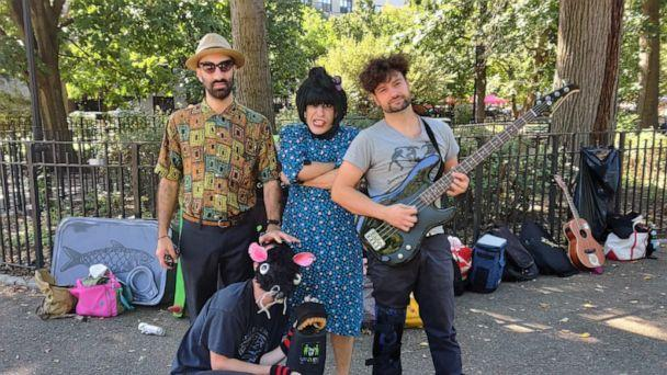 PHOTO: The Pinc Louds are comprised of Claudi Love, center, a singer and guitarist, alongside Raimundo Atal, left, on keyboard and Mark Mosterin, right on bass guitar. Jamie Emerson, bottom, a visual artist, performs alongside dressed as a rat. (ABC News)