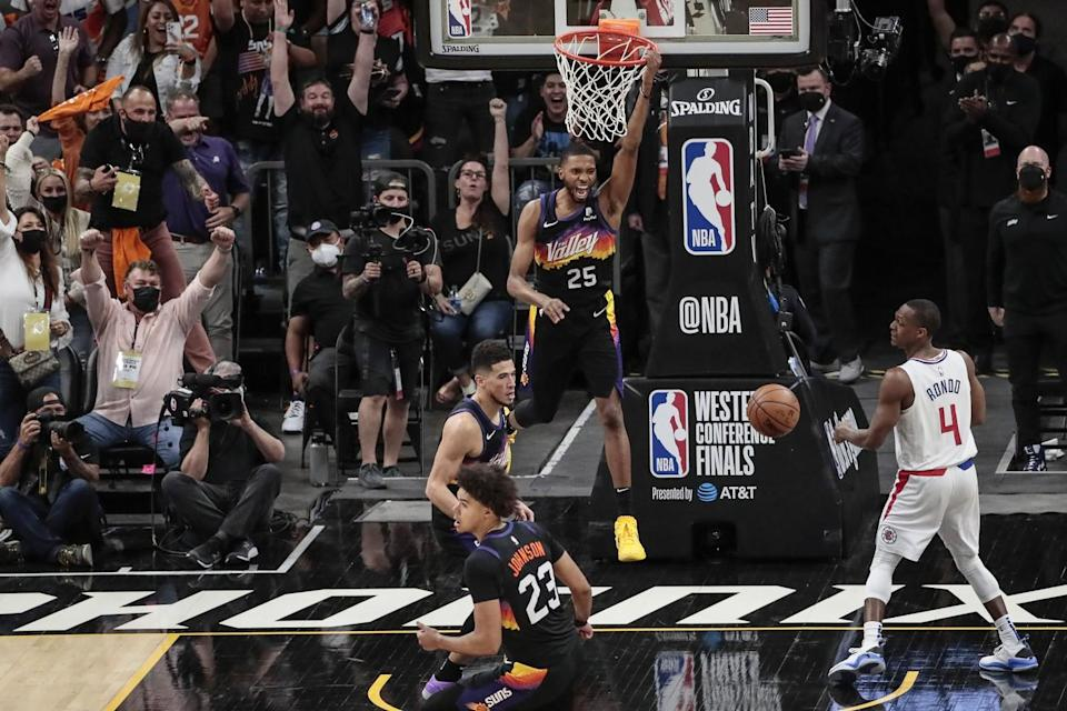 Suns forward Mikal Bridges celebrates after dunking against the Clippers in Game 1.
