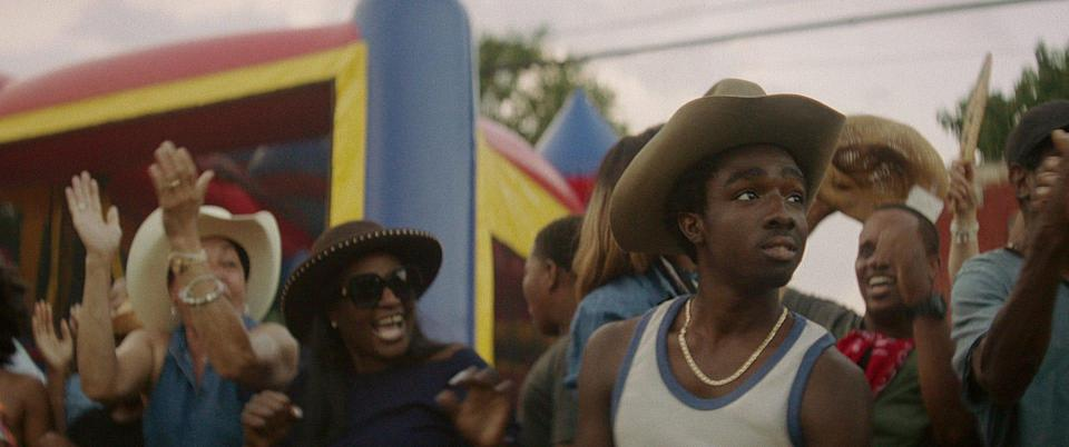 "Caleb McLaughlin stars as a troubled teen who learns about Black cowboy culture from his estranged father in Netflix's ""Concrete Cowboy."""