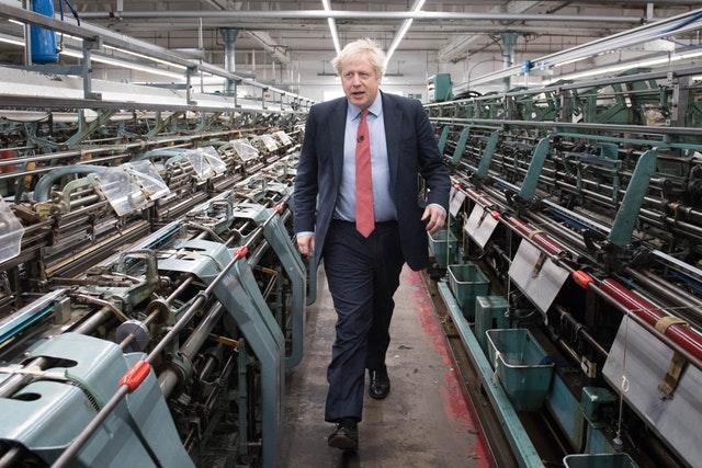 Prime Minister Boris Johnson during a visit to the John Smedley Mill in Matlock, Derbyshire