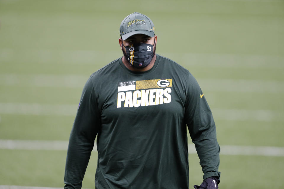 FILE - In this Sept. 27, 2020, file photo, Green Bay Packers defensive lineman Billy Winn warms up before an NFL football game against the New Orleans Saints in New Orleans. Winn encountered all kinds of adversity before making one of the NFL's most improbable comebacks this season. Yet he could always look inside his own home for inspiration. Whenever he wanted to feel sorry for himself over his misfortune with injuries, Winn only needed to witness his wife's battle with lupus to understand he had it comparably easy. (AP Photo/Tyler Kaufman, File)