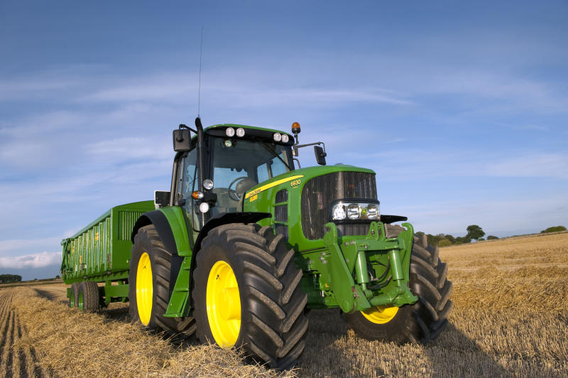 John Deere 6930 tractor with 10 tonne grain trailer on. (Photo by: Wayne Hutchinson/Farm Images/Universal Images Group via Getty Images)