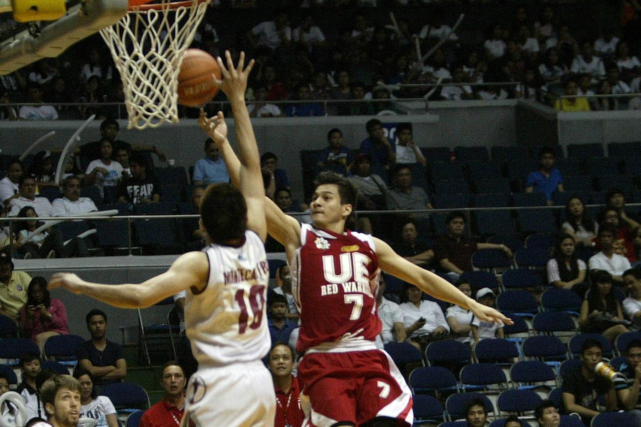 Lucas Tagarda of UE Red Warriors goes for the basket against the defense of UP Fighting Maroons durign the UAAP Season 74 basketball game held at Smart Araneta Coliseum, Quezon City. (Marlo Cueto/NPPA Images)