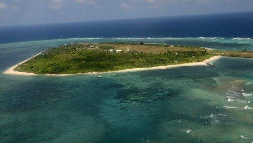 An aerial photo shows Thitu Island, part of the disputed Spratly group of islands, in the South China Sea
